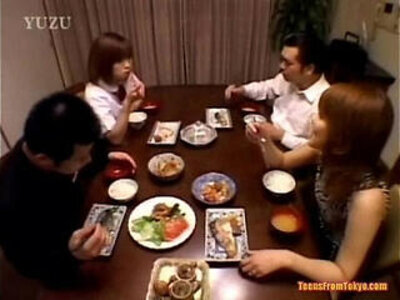 A Asian teenager is sitting at the dining table Wit | -asian-footjob-table-teenager-